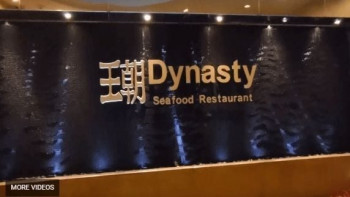 Black Scored Acrylic Water Wall with Raised Logo at Dynasty Seafood Restaurant in California